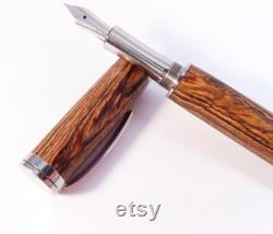 Engraved wood fountain pen.
